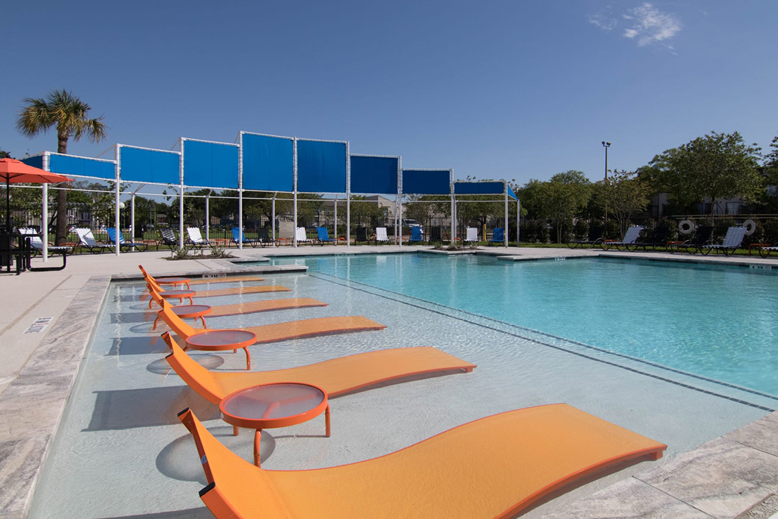 Swimming pool with lounge chairs at Holly Hall
