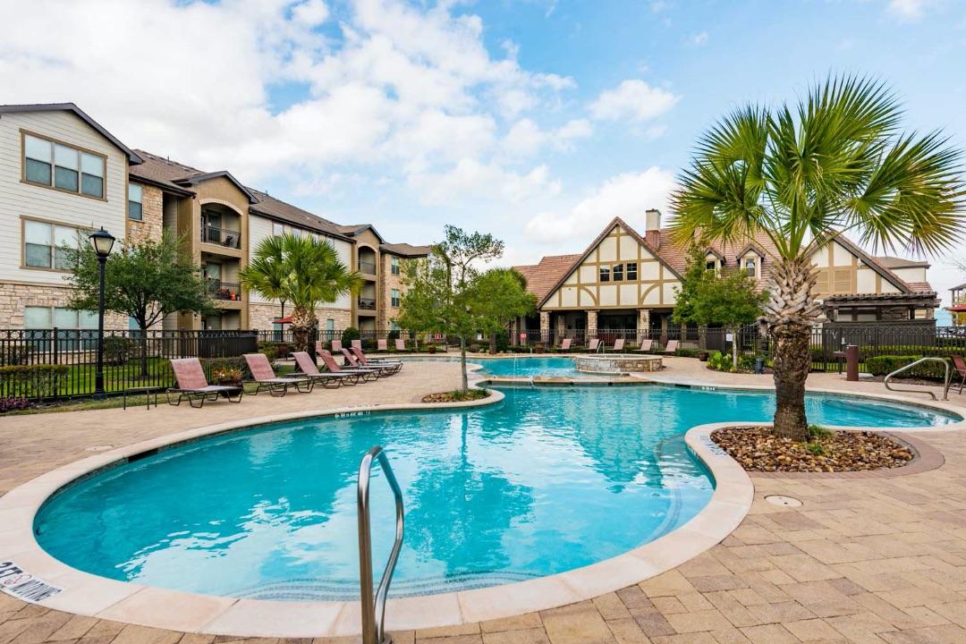Swimming pool and apartment exterior at Kensington Crossing