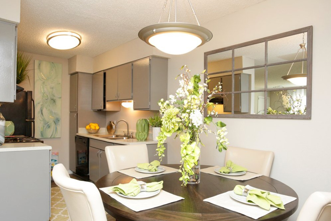 Set dining table and kitchen interior of Pindo Pointe apartment