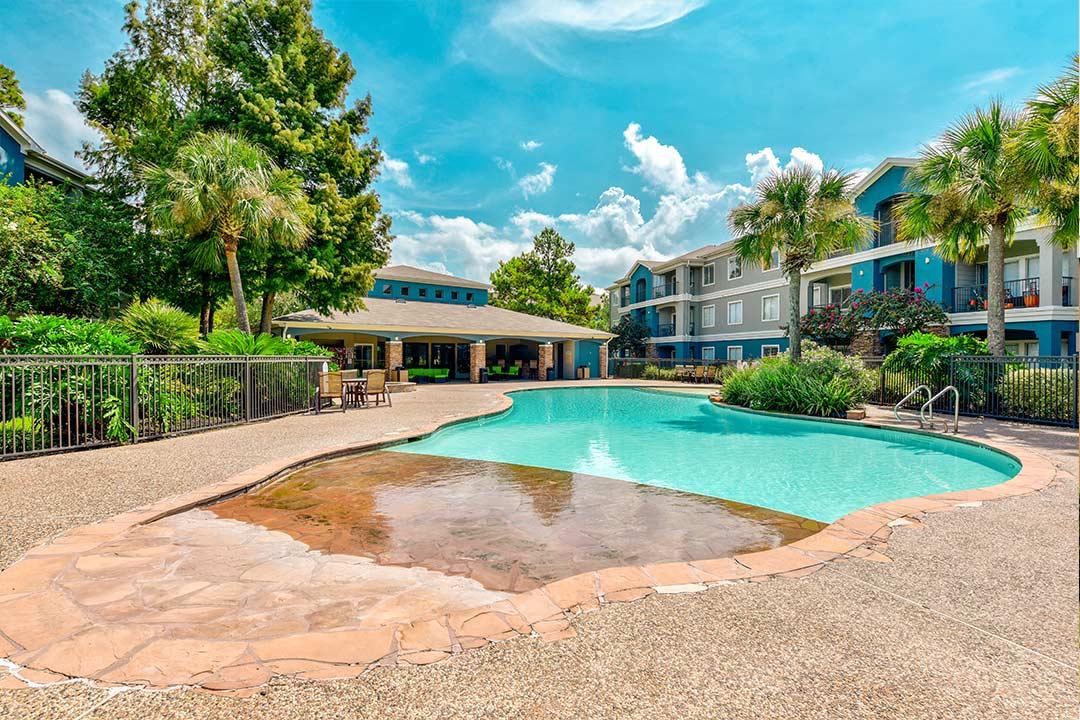 Exterior at Timberlakes at Atascocita with zero entry swimming pool